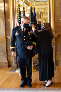 The Adjutant General, Maj. Gen. Michael J. Turley's new rank is placed by with wife MaryLou at the Utah State Capitol, in the Gold Room, at his promotion ceremony Aug. 6, 2020.
