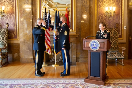 Command Sgt. Maj. Spencer Nielsen unfurled and posted the two-star flag followed by offering the first salute to the newly promoted Adjutant General, Maj. Gen.  Michael J. Turley Aug. 6, 2020.
