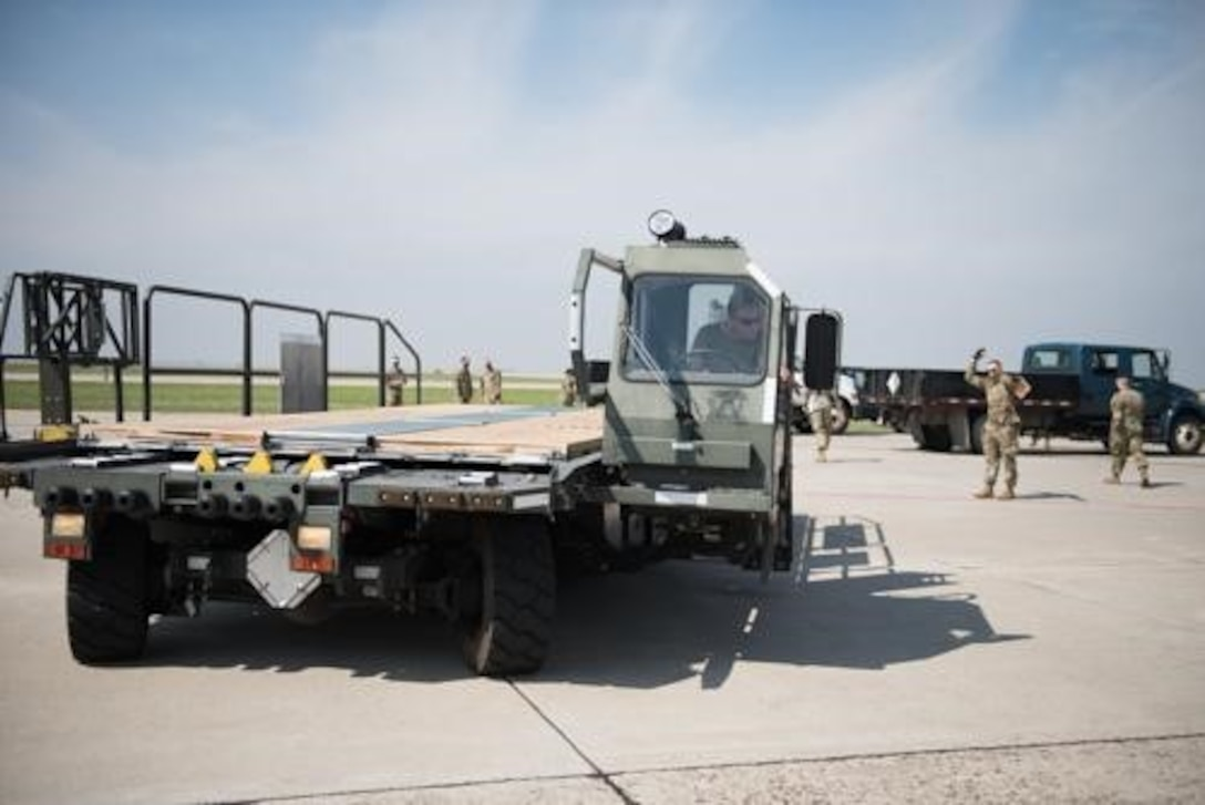 An Airman from the 5th Logistics Readiness Squadron hauls cargo at Minot Air Force Base, North Dakota, May 20, 2020. The 5th LRS modified pallets with rollers in order to efficiently change the way they work missions. (U.S. Air Force photo by Senior Airman Dillon Audit)