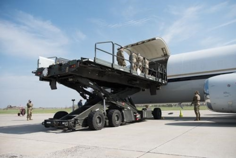 An Airman from the 5th Logistics Readiness Squadron hauls cargo at Minot Air Force Base, North Dakota, May 20, 2020. The 5th LRS modified pallets with rollers in order to efficiently change the way they work missions. (U.S. Air Force photo by Airmen 1st Class Jesse Jenny)