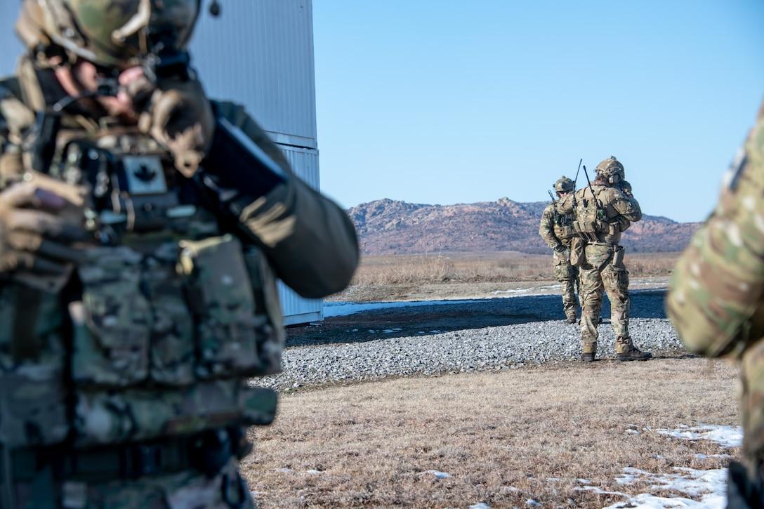 Military members check equipment