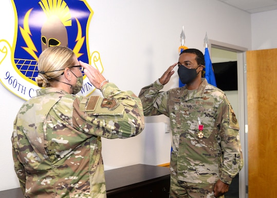 Col. Silas Darden, 960th Cyberspace Wing vice commander, is presented with the Legion of Merit by Col. Lori Jones, 960th CW commander, Aug. 8, 2020, at Joint Base San Antonio-Chapman Training Annex, Texas. (U.S. Air Force photo by Samantha Mathison)