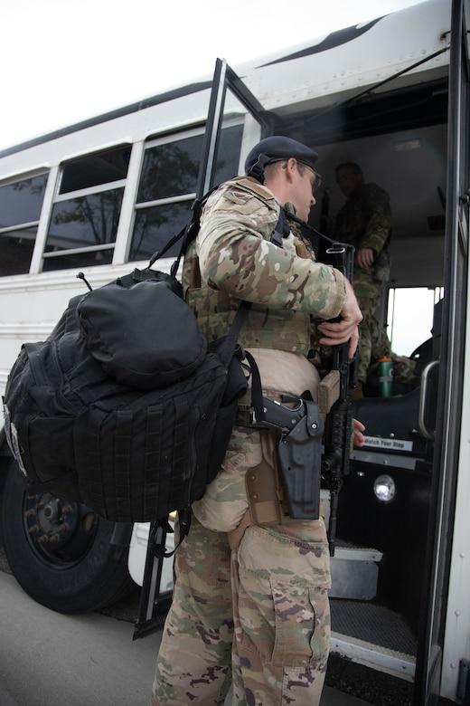 A Utah Air National Guard Airman boards a bus on their way to  downtown Salt Lake City, Utah