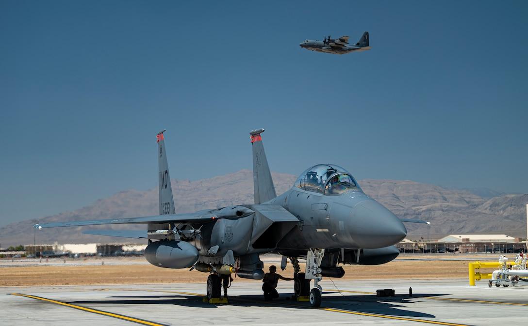 Aircraft sits on flight line.
