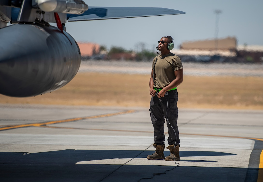 Airman stands on flight line.