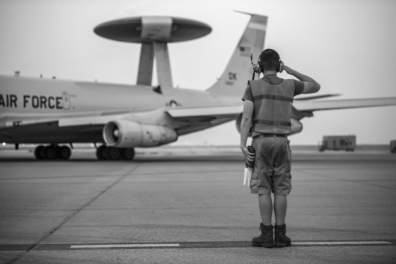 An Airman with the 380th Expeditionary Aircraft Maintenance Squadron E-3 Sentry Aircraft Maintenance Unit flags the 968th Expeditionary Airborne Air Control Squadron's E-3 Sentry (AWACS) here July 18, 2020.