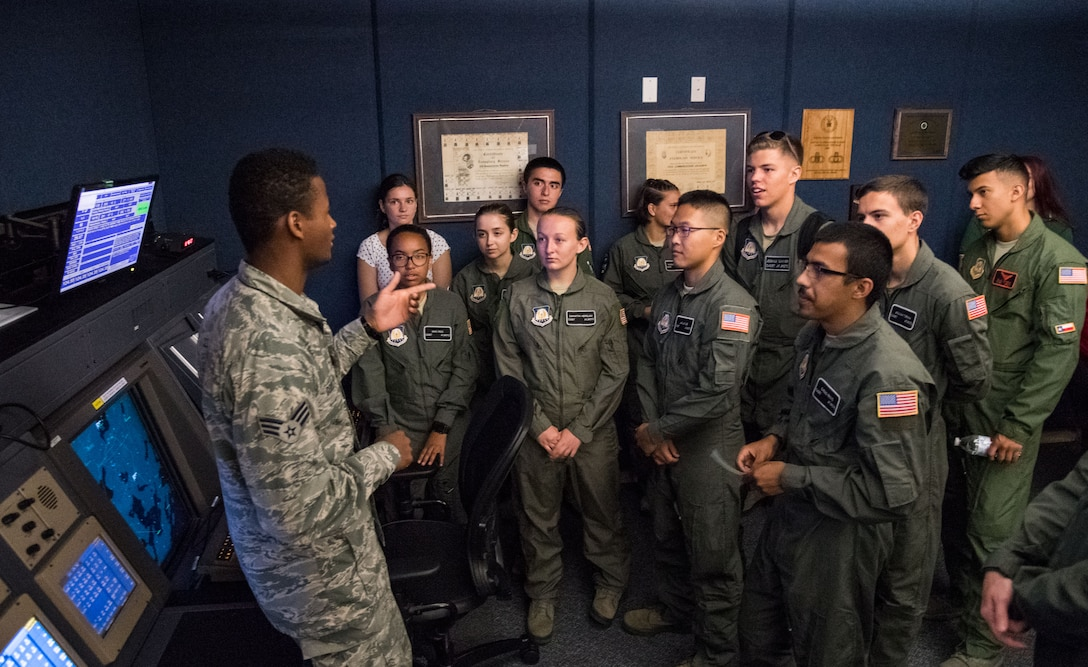 Senior Airman Kristapher Guillen, 436th Operations Support Squadron Radar Approach Control air traffic controller, answers questions from Air Force Junior Reserve Officers' Training Corps cadets during a tour of the RAPCON facility and control tower July 23, 2019, at Dover Air Force Base, Del. Cadets who attended the AFJROTC Summer Flight Academy at Delaware State University spent half of the day touring aviation-related facilities and aircraft. (U.S. Air Force photo by Roland Balik)