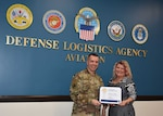 Defense Logistics Agency Aviation Commander Army Brig. Gen. David Sanford presents Christie Duke, program analyst, Command Programs Branch, DLA Aviation, with a certificate of appreciation for her work as the 2019 DLA Aviation Combined Federal Campaign manager during a ceremony held Mar. 3, 2020. Duke was recently awarded the national CFC Hero Award. This award is given to individuals working on the CFC who implemented a successful campaign and exemplified excellence throughout the campaign and is the highest award a campaign worker can receive through the CFC's recognition program. (Photo by Jackie Roberts)