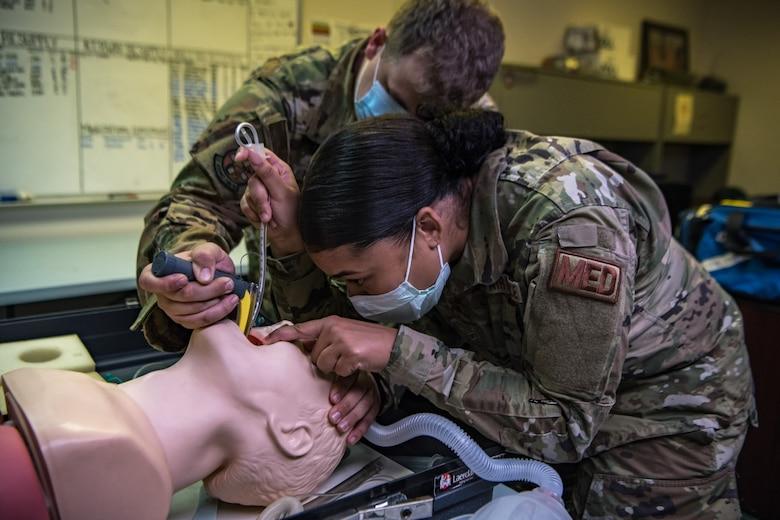 aerospace medical technicians intubates a training mannequin