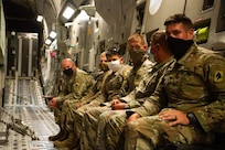 Kentucky National Guard Soldiers from 623rd Field Artillery Battalion await takeoff after loading their HIMARS onto a C-17 as apart of a HI-RAIN mission for their annual certification and training at the Louisville Air National Guard Base in Louisville, Ky., Aug. 6, 2020.