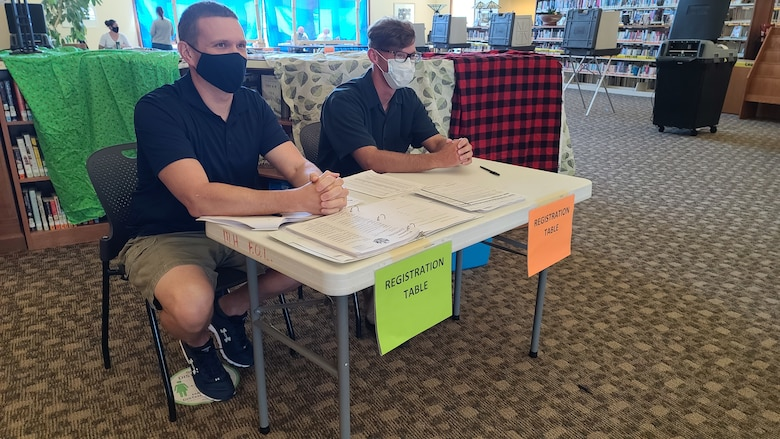 U.S. Air Force Capt. Matthew Shaw, an environmental management officer with the 115th Fighter Wing, and Sgt. Corey Nolden, an infantryman assigned to the 1st Battalion, 128th Infantry staff a voter registration desk at the Mount Horeb Public Library during the Aug. 11 election in Mount Horeb, Wis. Nearly 700 Citizen Soldiers and Airmen from the Wisconsin National Guard mobilized to serve as poll workers across 40 Wisconsin counties. (U.S. Air National Guard photo by Senior Master Sgt. Larkin Wilde)