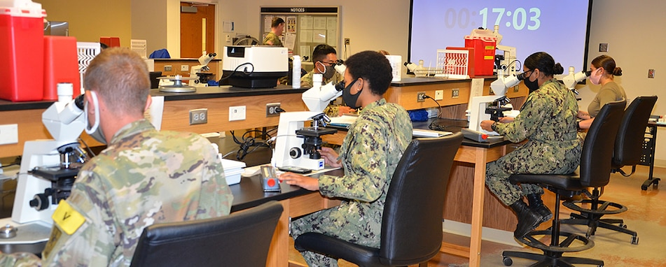 The Medical Education and Training Campus (METC) continues to train the world's finest Medics, Corpsmen, and Technicians - like these students in the physical therapy technician program - with extra safety precautions in place.