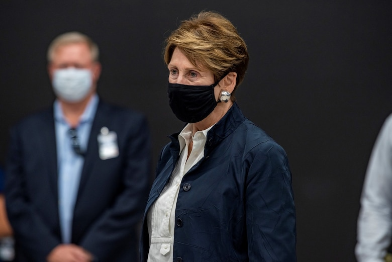 Barbara M. Barrett stands with face mask on.
