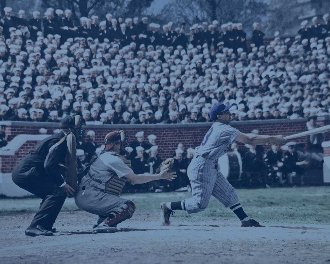 A batter, catcher and umpire play baseball at a stadium.