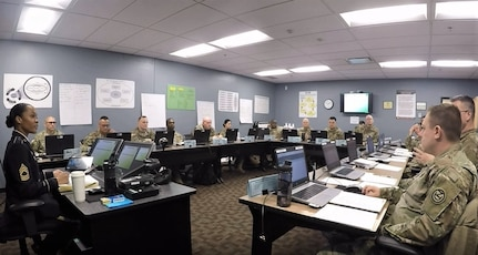 Master Sgt. Ericka Tew (left), Master Leader Course manager for the 83rd U.S. Army Reserve Readiness Training Center, teaches a class at Fort Knox, Kentucky. Tew was recently selected as the Reserve winner in the U.S. Army Training and Doctrine Command Instructor of the Year for 2020. (Courtesy photo)