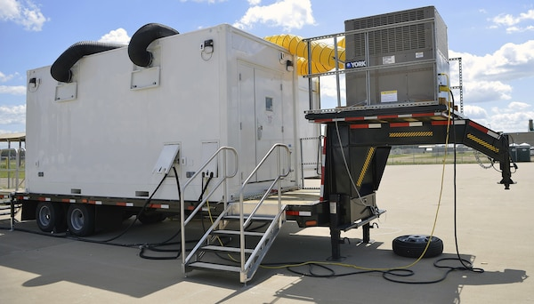 Isolation Support Facility (ISF) personnel of the 581st ASMC, 61st MMB and 1st Medical Brigade out of Fort Hood, Texas and a Mobile Medical Laboratory provided by FORSCOM work with Medics from the Minnesota National Guard on Camp Ripley July 28, 2020 to test Soldiers prior to mobilization for training. The testing which began June 18, 2020 for Task Force Viking (1/34th ABCT) completed just under 4,000 tests aiding the process to reduce training distractions or health risks due to COVID-19.