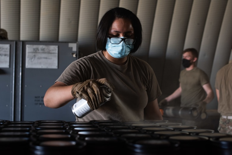 Senior Airman Olivia Vrba, a conventional maintenance specialist assigned to the 27th Special Operations Maintenance Squadron munitions flight, obliterates identifying information on former packaging for 105 MM rounds at Cannon Air Force Base, N.M., July 22, 2020. The information is covered up to protect the operations security, or OPSEC, of the base and its mission. (U.S. Air Force photo by Senior Airman Maxwell Daigle)