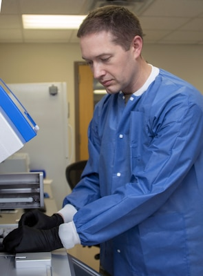 Army Capt. Eric Coate, Molecular Diagnostics officer in charge, loads patient samples for COVID-19 ribonucleic acid (RNA) testing at Brooke Army Medical Center, Joint Base San Antonio-Fort Sam Houston, April 9.