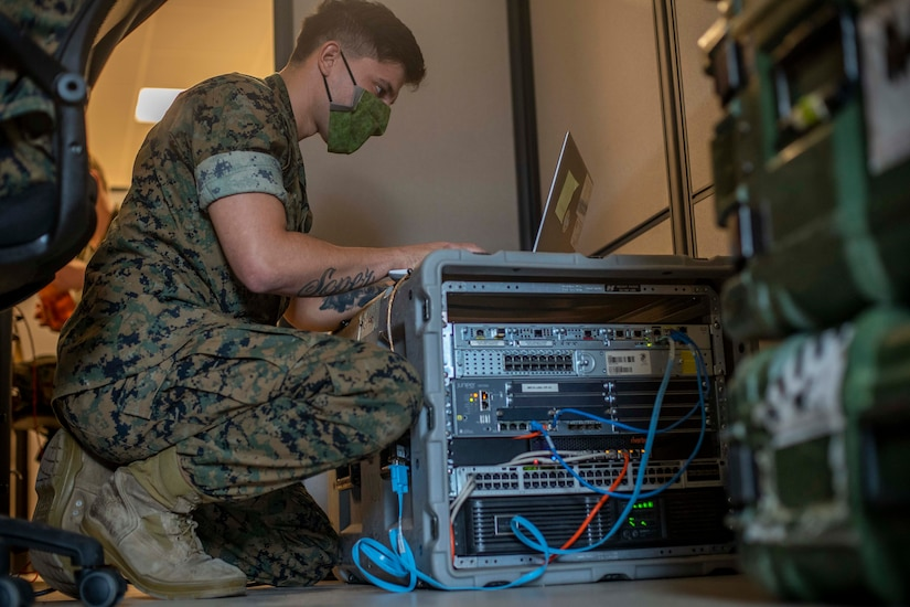 Marine works on a computer network.