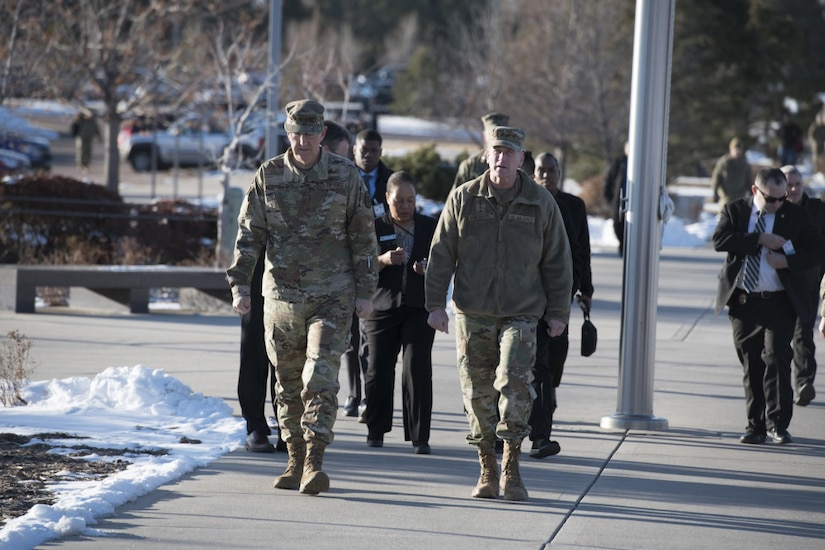 Two Air Force generals walk to a building for a briefing.