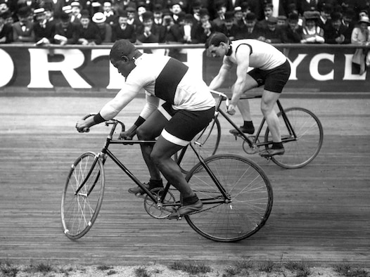 Marshall W. 'Major' Taylor (left) and Léon Hourlier race each other at Paris' Vélodrome Buffalo cycling track in 1909. Taylor, an Indianapolis native, was an African American world champion cyclist who lived and trained in nearby Worcester, Massachusetts at the turn of the last century. (Courtesy Photo, Agence Rol / Public Domain)