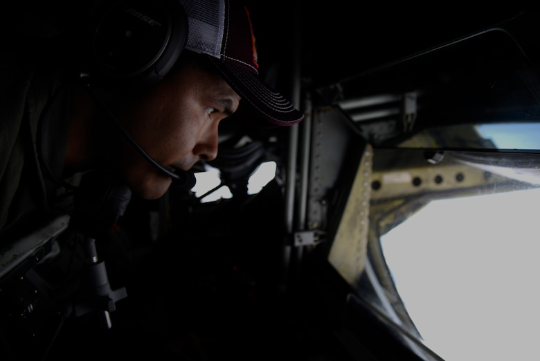 U.S. Air Force Tech. Sgt. Jose Cruz, 384th Air Refueling Squadron boom operator, conducts air refueling during field training exercise Red Flag Alaska 20-3, Aug. 5, 2020. This exercise reinforces the United States' continued commitment to the region as a Pacific nation, leader and power. (U.S. Air Force photo by Staff Sgt. Jesenia Landaverde)