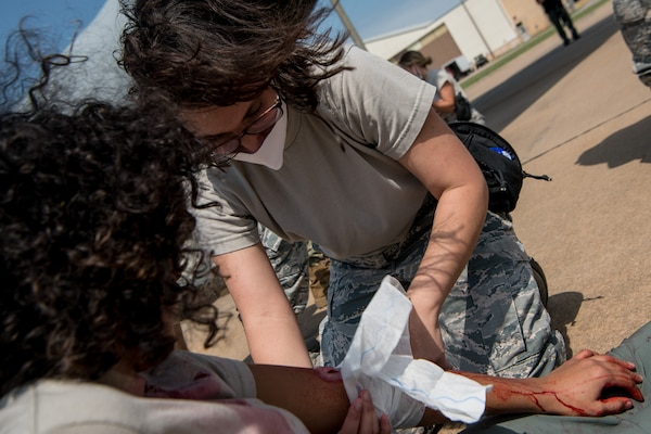 aerospace medical technician treats simulated wounded patient
