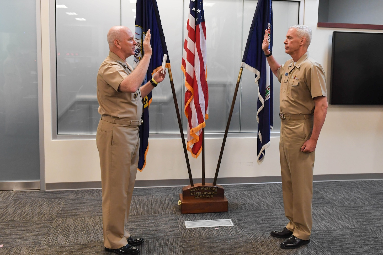 Admiral Christopher W. Grady, left, U.S. Fleet Forces commander, promotes Rear Admiral Fred I. Pyle in a frocking ceremony at Navy Warfare Development Command. The promotion of Pyle, NWDC commander, will be effective August 1, 2020. He is a native of McAlisterville, Pa., and a 1990 graduate of Pennsylvania State University.  Frocking is the Navy's practice of allowing promotion selectees to wear the insignia of the higher grade before the official date of promotion.  For an expanded discussion on the origins of this practice, please visit the Naval History and Heritage Command at https://www.history.navy.mil/research/library/online-reading-room/title-list-alphabetically/f/frocking.html. (U.S. Navy photo by MC1 Jason Pastrik, NWDC/Released)