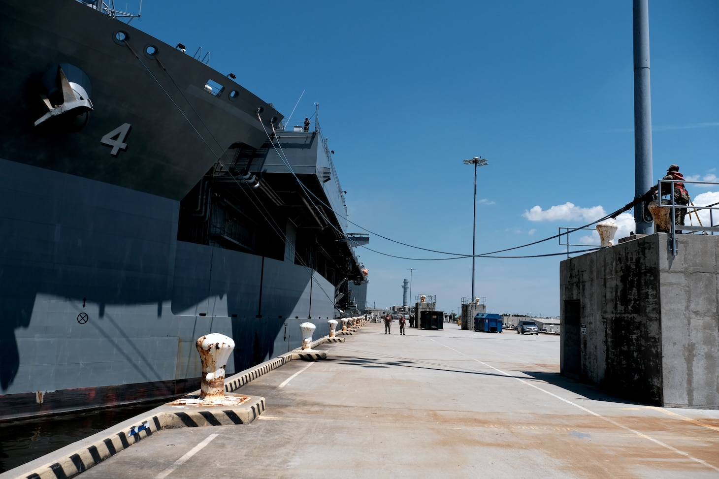 "NORFOLK, Va. (July 27, 2020) Sailors perform line handling duties as USS Hershel ""Woody"" Williams (ESB 4) departs Naval Station Norfolk, Va. for deployment. Williams is conducting its inaugural deployment following its commissioning in March. (U.S. Navy photo by Mass Communication Specialist 1st Class Joshua D. Sheppard)"
