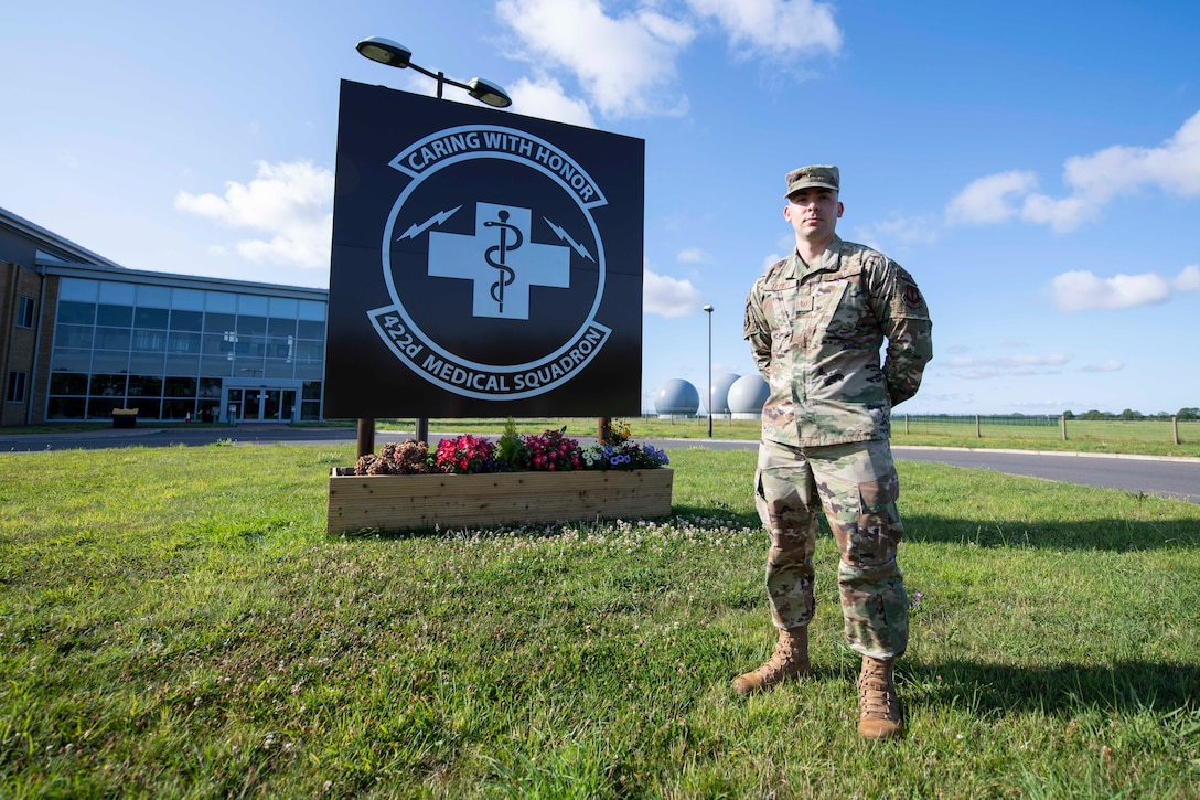 U.S. Air Force Tech. Sgt. Steve Zavala, 422nd Medical Squadron medical operations flight chief and trusted care champion, poses for a photo in front of the 422nd MDS building at RAF Croughton, England, August 3, 2020. Zavala discovered a COVID-19 testing technique that needed to be changed, so he elevated the concern and impacted testing procedures across the Department of Defense. (U.S. Air Force photo by Airman 1st Class Jennifer Zima).