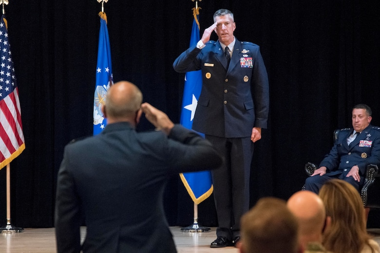 photo of major general craige saluting a member in the audience