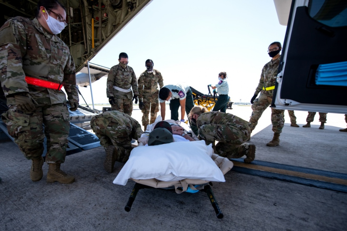 One of eight spinal cord injury patients from Audie Murphy Veterans Affairs Medical Center, South Texas Veterans Health Care System, San Antonio, Texas, is moved onto a U.S. Air Force C-130 aircraft at Joint Base San Antonio-Kelly Airfield, Texas, Tuesday, July 14, 2020, for a brief flight to Dallas Love Field Airport, Texas.