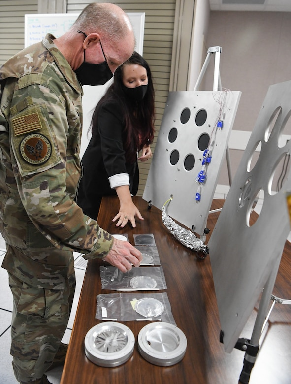 Vice Chief of Staff of the Air Force Gen. Stephen Wilson looks at materials tested in the Space Threat Assessment Testbed at Arnold Air Force Base, Tenn., as Kellye Burns, an Arnold Engineering Development Complex (AEDC) space test engineer briefs him, Aug. 11, 2020. Materials testing can be conducted in STAT to understand the performance of materials in and susceptibility to a realistic space environment. (U.S. Air Force photo by Jill Pickett)