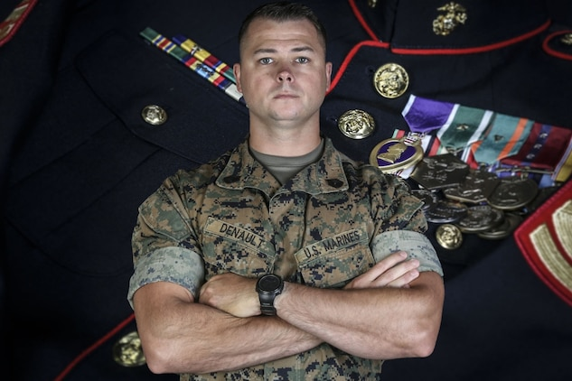 U.S. Marine Gunnery Sgt. Frank Denault, the chief instructor for Infantry Unit Leader Course, Advanced Infantry Training Battalion, School of Infantry - West, poses for a studio portrait in 22 Area on Marine Corps Base Camp Pendleton, California, Aug. 5, 2020. Denault earned his Purple Heart for events that occurred in Sangin, Afghanistan, November 2010. Denault is a native of Kankakee, Illinois. (U.S. Marine Corps photo illustration by Lance Cpl. Alison Dostie)