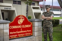 U.S. Marine Sgt. Roxanne Gorostieta, the administrative chief with the Command Element, I Marine Expeditionary Force, poses in front of the command's sign in 21 Area on Marine Corps Base Camp Pendleton, California, July 28, 2020. Gorostieta uses her knowledge and experience in fitness and the Marine Corps Martial Arts Program to train and educate her Marines. Gorostieta is a native of Phoenix. (U.S. Marine Corps photo by Lance Cpl. Alison Dostie)