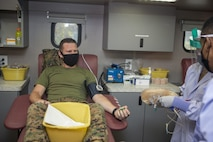 U.S. Marine Capt. Kyle Kuhn, the assistant officer in charge of the Center for Naval Aviation Technical Training Marine Detachment, waits to donate blood and be tested for coronavirus antibodies outside of the CNATT schoolhouse on Marine Corps Base Camp Pendleton, California, Aug. 10, 2020. The event was hosted by the Armed Services Blood Program. Each donor went through a screening process, then donated one pint of blood, which could save up to three lives. As part of the screening process, each donation was tested for COVID-19 antibodies, which could determine if the donor had previously been exposed to the virus. (U.S. Marine Corps photo by Lance Cpl. Drake Nickels)