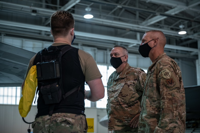An Airman talks to his commander and his chief about his experience with the personal cooling system.