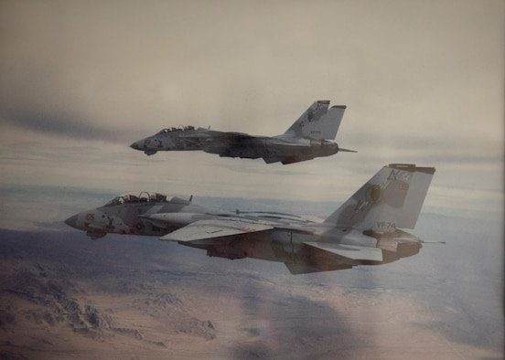 Two F-14s fly in formation.