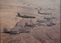 Various aircraft fly in formation over the Nevada Test and Training Range.