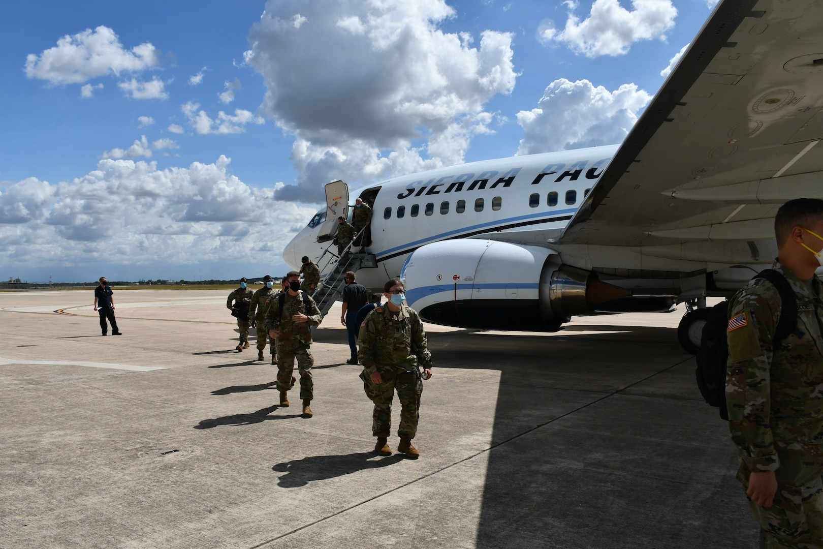 Soldier getting off airplane.