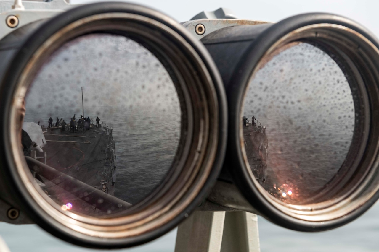 A reflection is seen in a set of binoculars.