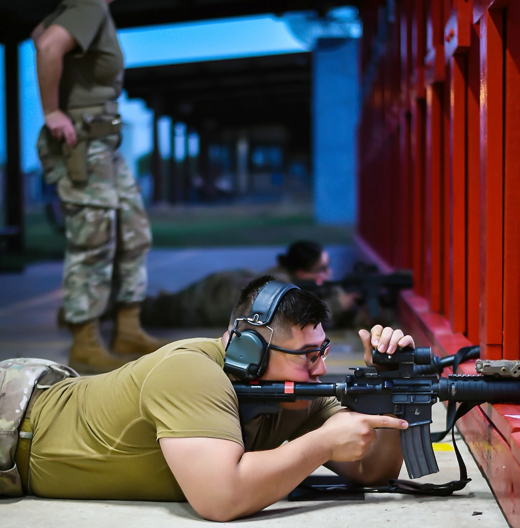 Senior Airman Sam Garza and Staff Sgt. Christina Richards, 149th Security Forces Squadron, Air National Guard, shoot their weapons from the prone position at a firing range at Joint Base San Antonio-Chapman Annex Aug. 12.