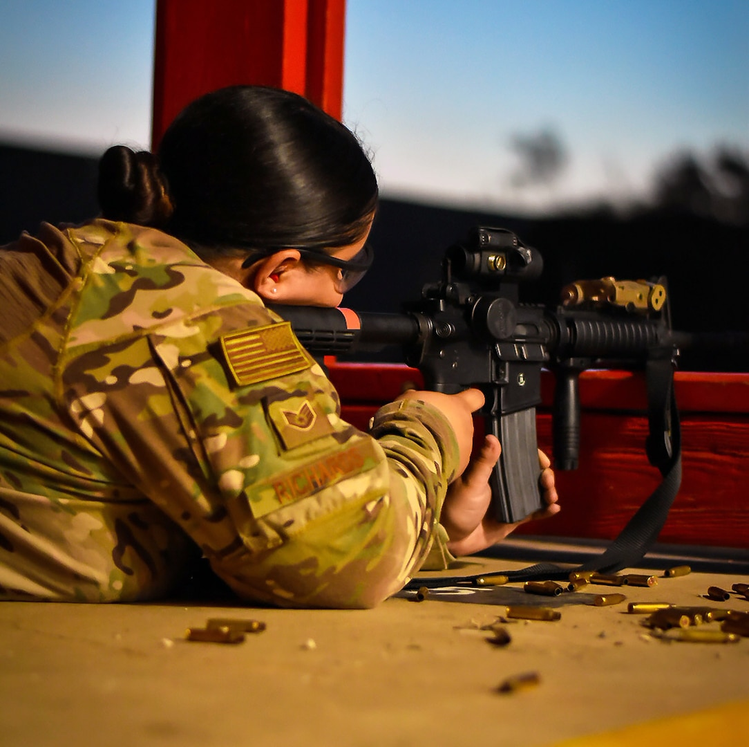 Staff Sgt. Christina Richards, 149th Security Forces Squadron, Air National Guard, shoots her weapon from the prone position at a firing range at Joint Base San Antonio-Chapman Annex Aug. 12.