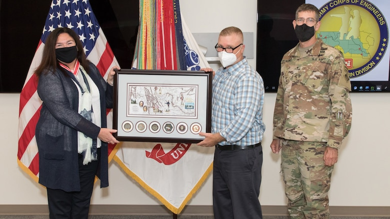 Brig. Gen. Peter D. Helmlinger and Tony Kirk present Patti Williams an award with commanders' coins from the Kansas City, Portland, Omaha, Seattle and Walla Walla districts and Northwestern Division.