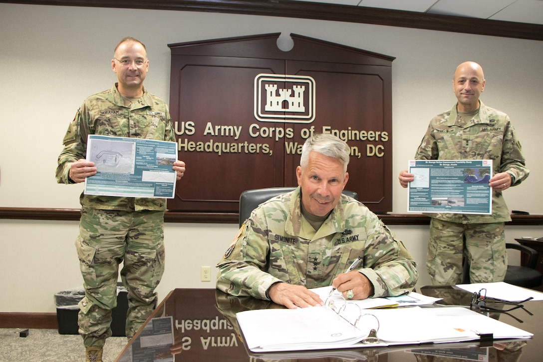 """Lt. Gen. Todd Semonite, USACE Commanding General and 54th Chief of Engineers, poses while signing the St. George Harbor Improvement Chief's Report August 13, 2020, in the Washington D.C. Headquarters of the U.S. Army Chief of Engineers as Maj. Gen. William """"Butch"""" Graham (left) and Maj. Gen. (Promotable) Scott Spellmon (right) observe."""