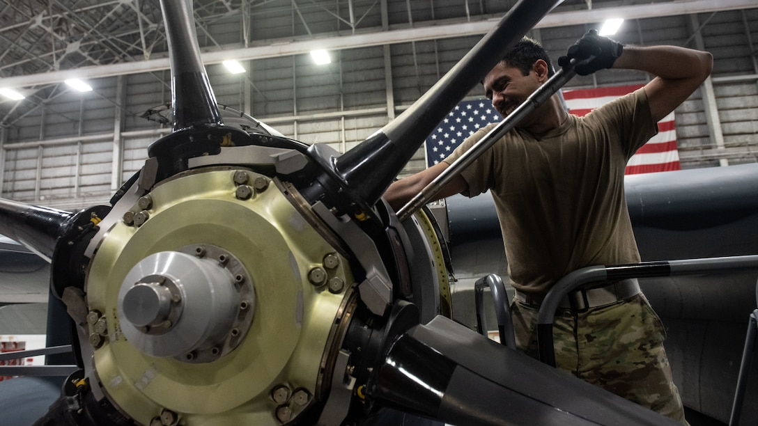 irmen from the 353rd Special Operations Aircraft Maintenance Squadron perform engine maintenance on an MC-130J Commando II Aug. 6, 2020, at Kadena Air Base, Japan.