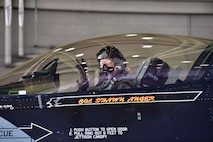 U.S. Air Force Col. Shawn E. Anger, the 354th Fighter Wing commander, renders the 18th Aggressor Squadron 'have at you' gesture during his fini flight at Eielson Air Force Base, Alaska, Aug. 13, 2020. Anger is a command pilot with more than 2,900 hours flight hours throughout his career. (U.S. Air Force photo by Senior Airman Beaux Hebert)