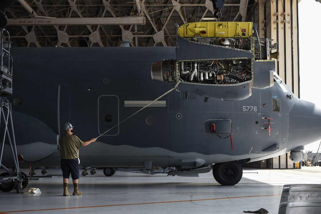 Airmen from the 353rd Special Operations Aircraft Maintenance Squadron perform engine maintenance on an MC-130J Commando II Aug. 6, 2020, at Kadena Air Base, Japan.