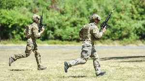 Airmen from the 25th Air Support Operations Squadron conduct field training exercises at Bellows Air Force Station, Hawaii, July 29, 2020. Airmen were evaluated on communication skills and tactical movements in a simulated combat environment. (U.S. Air Force photo by Tech. Sgt. Anthony Nelson Jr.)