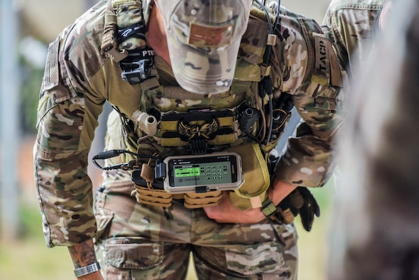 Tech. Sgt Joshua McKeever, 25th Air Support Operations Squadron tactical air control party Airman, demonstrates how the EvolutionONE, a GPS and communication system, is designed to attach to body armor at Wheeler Army Airfield, Hawaii, August 4, 2020. The lesson helped Airmen understand the communications network they will deal with in a deployed location. (U.S. Air Force photo by Tech. Sgt. Anthony Nelson Jr.)